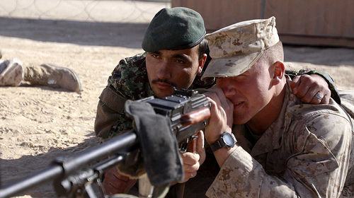 A U.S. Marine and Afghan National Army member at a weapons class in Afghanistan.