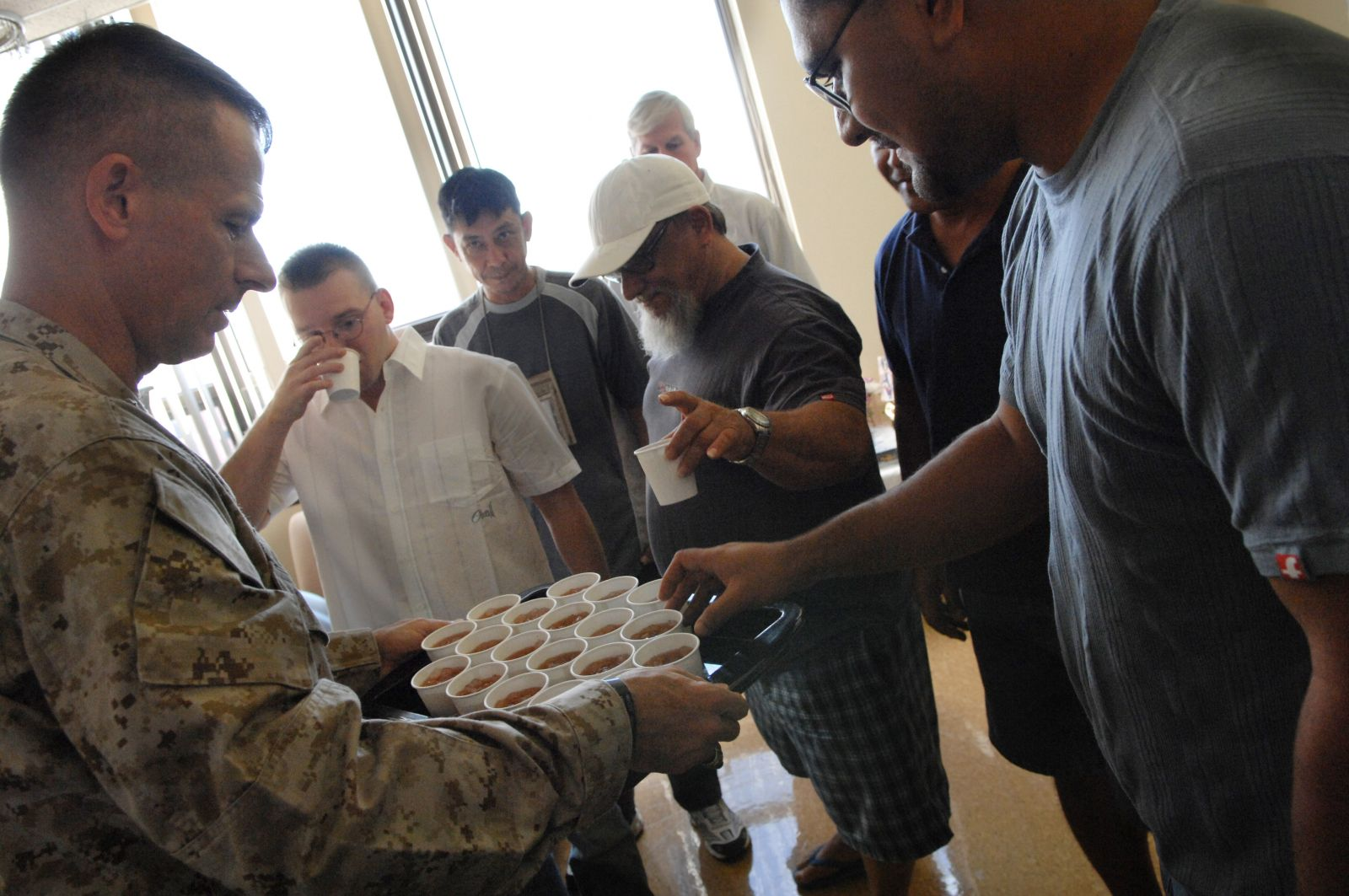 Marine Gen. Peter Pace serves iced tea to PTSD sufferers.