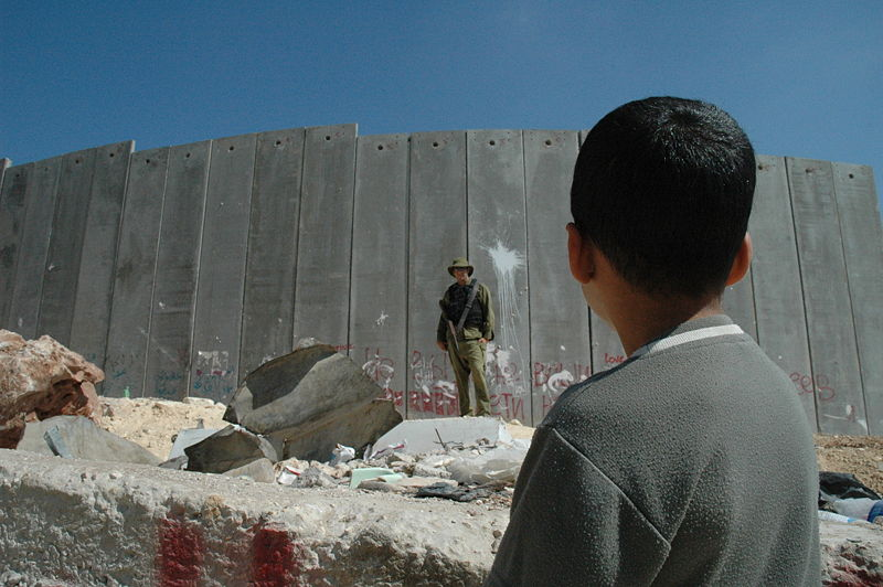 800px-Boy_and_soldier_in_front_of_Israeli_wall.jpg