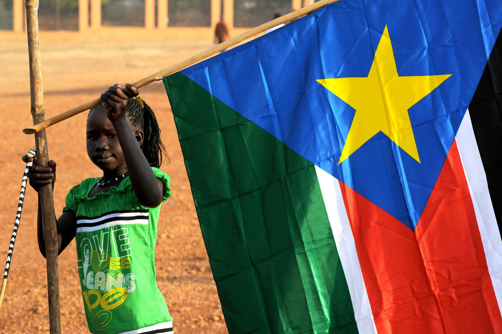 A_young_girl_hangs_the_South_Sudan_flag_(5925619011).jpg