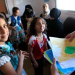 Refugee_children_from_Syria_at_a_clinic_in_Ramtha,_northern_Jordan_(9613477263).jpg