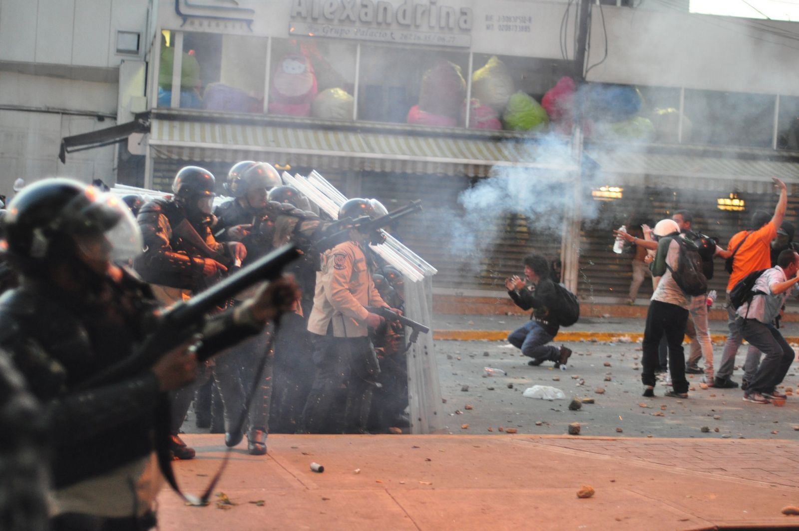 Tear_gas_used_against_protest_in_Altamira,_Caracas;_and_distressed_students_in_front_of_police_line.jpg