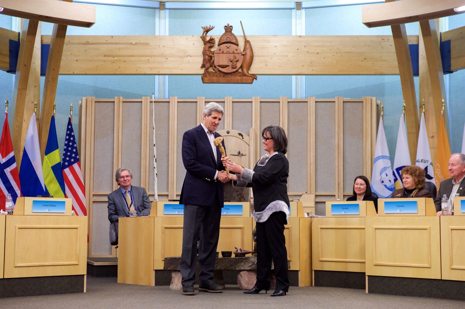 Arctic_Council_Chairman_Leona_Aglukkaq_of_Canada_Passes_a_Ceremonial_Gavel_to_Secretary_Kerry.jpg